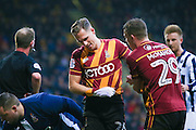 Bradford City defender Matthew Kilgallon (26) feels his injury during the EFL Sky Bet League 1 match between Bradford City and Millwall at the Northern Commercials Stadium at Valley Parade, Bradford, England on 21 January 2017. Photo by Simon Davies.