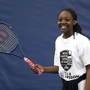 May 15, 2014, New Haven, Connecticut:<br /> A girl participates in a free tennis lesson and clinic Thursday, May 15, 2014 in advance of the 2014 New Haven Open at the Yale University Tennis Center in New Haven, Connecticut. <br /> (Photo by Billie Weiss/New Haven Open)