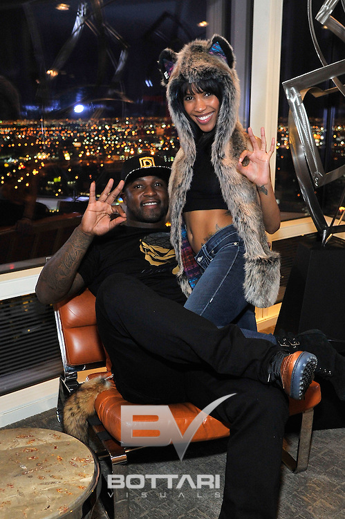 LAS VEGAS, NV - FEBRUARY 19:  DYMELYFE CEO and owner DJ Williams (L) and guest attend the FlauSachika Groups exclusive magic suite party at Aria Resort & Casino at CityCenter on February 19, 2013 in Las Vegas, Nevada.  (Photo by Jeff Bottari/WireImage)