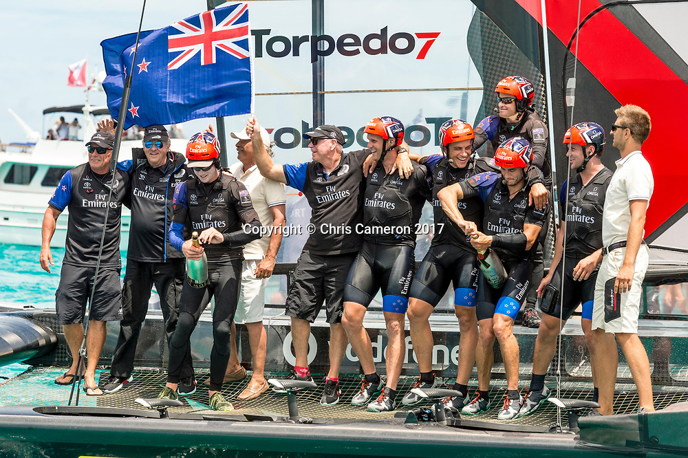 The Great Sound, Bermuda, 26th June 2017. Emirates Team New Zealand win race nine to win the America's Cup. Helmsman Peter Burling and trimmer Blair Tuke prepare to spray Moet Champagne in celebration.<br /> Copyright photo: Chris Cameron / www.photosport.nz