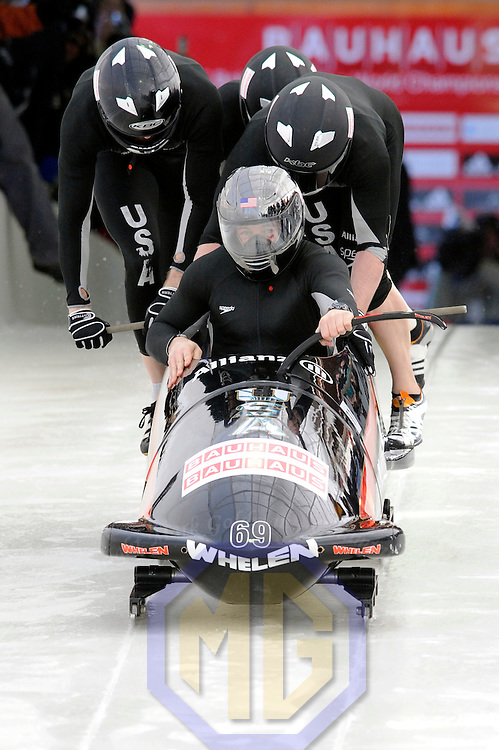 28 February 2007:     The USA 2 bobsled driven by Todd Hays with sidepushers T.J. Burns and Alex Sprague, and brakeman  Bill Schuffenhauer jump into the sled at the start of the 2nd run at the 4-Man World Championships competition on February 27 at the Olympic Sports Complex in Lake Placid, NY.