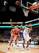 Jan. 8, 2012; Phoenix, AZ, USA; Milwaukee Bucks forward Drew Gooden (0) looks for the ball against the Phoenix Suns small forward Jared Dudley (3) during the first half at the US Airways Center. Mandatory Credit: Jennifer Stewart-US PRESSWIRE.