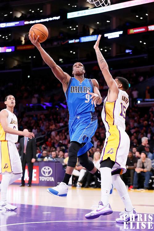 12 April 2014: Dallas Mavericks guard Rajon Rondo (9) goes for the layup past Los Angeles Lakers guard Jabari Brown (15) during the Dallas Mavericks 120-106 victory over the Los Angeles Lakers, at the Staples Center, Los Angeles, California, USA.