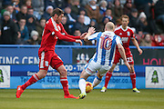 Birmingham City  forward, on loan from Burnley, Lukas Jutkiewicz (15)  is tackled by Huddersfield Town midfielder, on loan from Manchester City, Aaron Mooy (10)  during the EFL Sky Bet Championship match between Huddersfield Town and Birmingham City at the John Smiths Stadium, Huddersfield, England on 5 November 2016. Photo by Simon Davies.