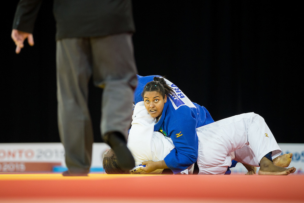 Maria Suelen Altheman of Brazil looks to the referee as she pins Leidi German of the Dominican Republic to win the bronze medal in the women's judo +78kg class at the 2015 Pan American Games in Toronto, Canada, July 14,  2015.  AFP PHOTO/GEOFF ROBINS