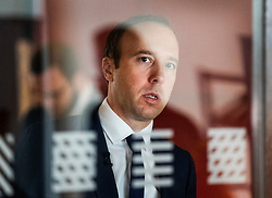 © Licensed to London News Pictures. 10/06/2019. London, UK. Matt Hancock looks through a glass door into the room where he is launching his Conservative Party leadership bid. Contenders have until 5pm today to put themselves forward in the contest to replace Theresa May. Photo credit: Peter Macdiarmid/LNP