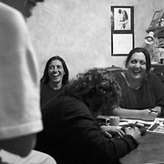 Veronica Sorbera, Norma Bireni, and Maria Rachid respond to a comment from Adriana Heredia during an organizational meeting at La Fulana.