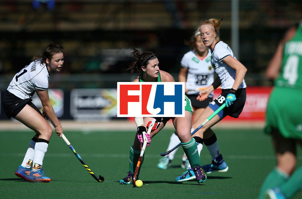 JOHANNESBURG, SOUTH AFRICA - JULY 10: Roisin Upton of Ireland looks to pass under pressure from Amelie Wortmann of Germany during day 2 of the FIH Hockey World League Semi Finals Pool A match between Germany and Ireland at Wits University on July 10, 2017 in Johannesburg, South Africa. (Photo by Jan Kruger/Getty Images for FIH)