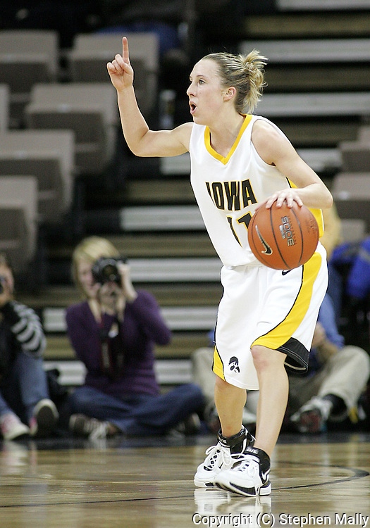 25 JANUARY 2007: Iowa guard Kristi Smith (11) calls a play in Iowa's 80-78 overtime loss to Minnesota at Carver-Hawkeye Arena in Iowa City, Iowa on January 25, 2007.