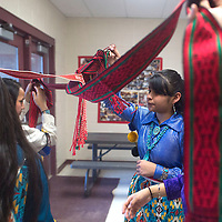 From left, Kailey Curley, Melicia Yazzie, Aleja Castruita and Tristan Waquiu rehearse the ribbon dance at Ganado Middle School in Ganado Wednesday during the Winterfest.