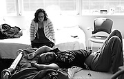 Exhausted, Kevin lays on his hospital bed following a bone marrow transplant as his girlfriend at the time, Erika Sorg, sits by. - 6/12/2009