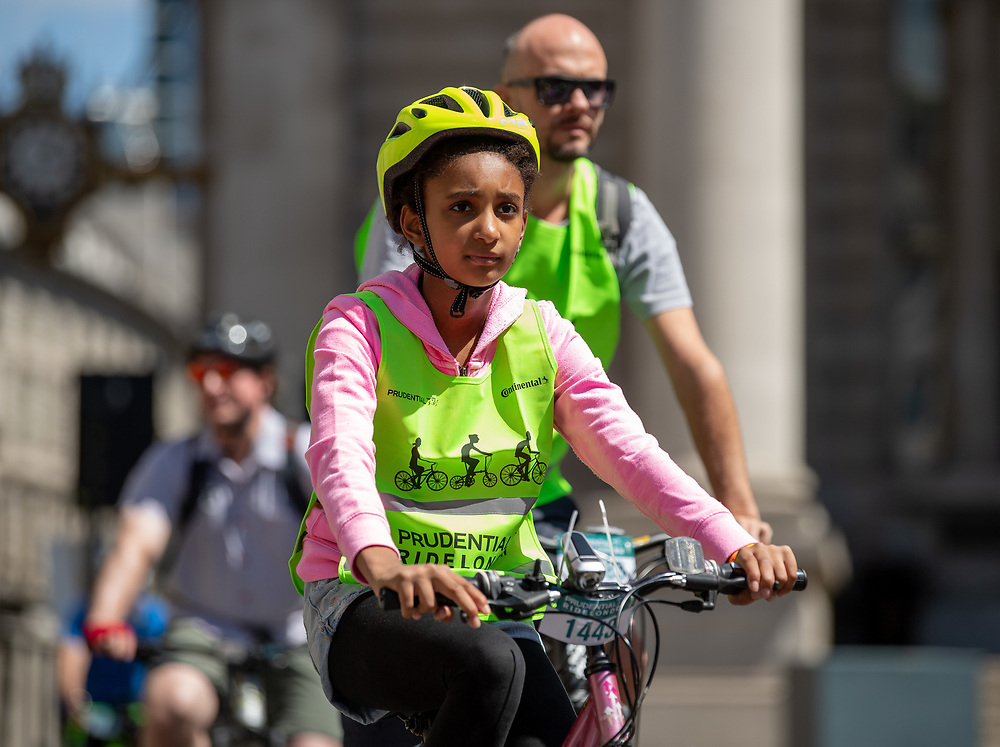 Young cyclist riding past The Bank of England and The Royal Exchange. Prudential RideLondon FreeCycle. Saturday 28th July 2018<br /> <br /> Photo: Thomas Lovelock for Prudential RideLondon<br /> <br /> Prudential RideLondon is the world's greatest festival of cycling, involving 100,000+ cyclists - from Olympic champions to a free family fun ride - riding in events over closed roads in London and Surrey over the weekend of 28th and 29th July 2018<br /> <br /> See www.PrudentialRideLondon.co.uk for more.<br /> <br /> For further information: media@londonmarathonevents.co.uk