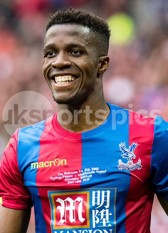 WILFRIED ZAHA asked Crystal Palace to leave.<br /> <br /> Wilfried Zaha of Crystal Palace is all smiles during the The FA Cup 2016 Final match between Crystal Palace and Manchester United at Wembley Stadium, London, England on the 21st  May 2016. Photo by Liam McAvoy.