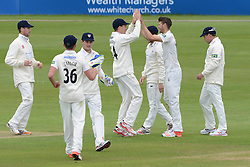 David Payne of Gloucestershire celebrates with Peter Handscomb of Gloucestershire as Billings is caught by Gareth Roderick of Gloucestershire after Payne's bowl - Photo mandatory by-line: Dougie Allward/JMP - Mobile: 07966 386802 - 19/05/2015 - SPORT - Cricket - Bristol - County Ground - Gloucestershire v Kent - LV=County Cricket Division 2