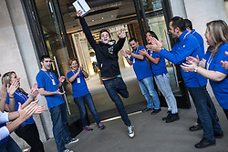 The new iPad Air on sale in London. <br /> Richard Parkes, 18 from Cambridge gets cheered by Apple employees at Covent Garden's Apple store, London, United Kingdom. Friday, 1st November 2013. Picture by Daniel Leal-Olivas / i-Images