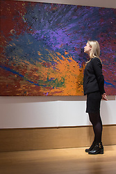 "Bonhams, Mayfair, London. A woman admires Shozo Shimamoto's ""Magi 903"" valued at between £60,000 - £80,000, to be auctioned at Bonhams post-war and Contemporary art sale. ///FOR LICENCING CONTACT: paul@pauldaveycreative.co.uk TEL:+44 (0) 7966 016 296 or +44 (0) 20 8969 6875. ©2015 Paul R Davey. All rights reserved."