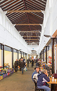 People shopping in traditional market covered arcade called The Shambles, Devizes, Wiltshire, England, UK