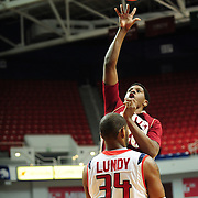 Denver's forward, Royce O'Neale (20), shoots over South Alabama's forward Antione Lundy (34) in the first half of play in Mobile, AL. Denver leads South Alabama 30-24 at halftime on January 7, 2012...