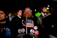 Teri Mcclain of Seattle Washington, watches poll numbers being announced as supporters take to Chicago's Grant Park for the election night results for the presidential race between Sen. Barak Obama (D-IL) and Sen. John McCain (R-AZ) Tuesday Nov. 4, 2008 Chicago IL.