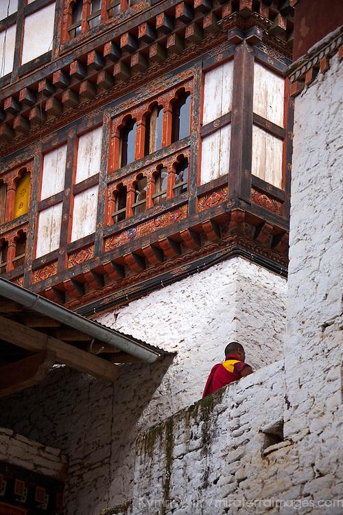 Asia, Bhutan, Trongsa. Trongsa Dzong architecture with monk.