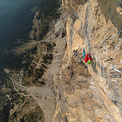 Sonnie Trotter leading an aesthetic 5.12c pitch on the upper tier of Castles in the Sky, 5.14a, high on Mt Castle, Banff National Park, Alberta, Canada.