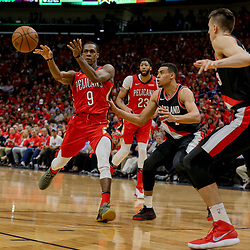 Apr 21, 2018; New Orleans, LA, USA; New Orleans Pelicans guard Rajon Rondo (9) passes off the ball as Portland Trail Blazers guard Wade Baldwin IV (2) defends during the second half in game four of the first round of the 2018 NBA Playoffs at the Smoothie King Center. Mandatory Credit: Derick E. Hingle-USA TODAY Sports