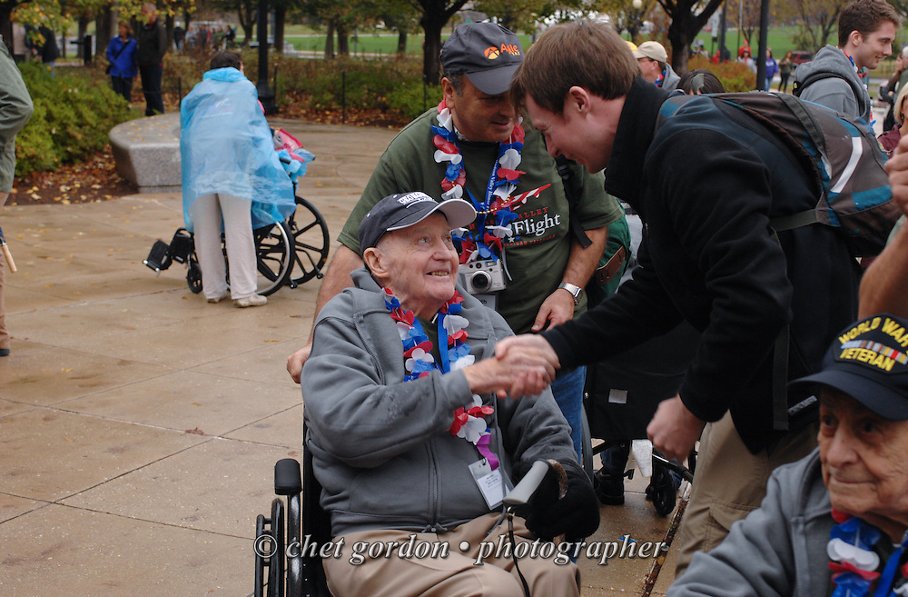 WWII Veterans and their escorts onboard the Hudson Valley Honor Flight #10 at the WWII Memorial in Washington, DC on Saturday, November 7, 2015. Sixty-four veterans from the Westchester County (NY) area toured the WWII and Marine Corps War Memorials, as well as Arlington National Cemetery. Hudson Valley Honor Flight is a chapter of the Honor Flight Network, which provides free flights for WWII Veterans and tours of the WWII Memorial constructed in their honor, and other sites in the nation's capital.  © Chet Gordon / Hudson Valley Honor Flight
