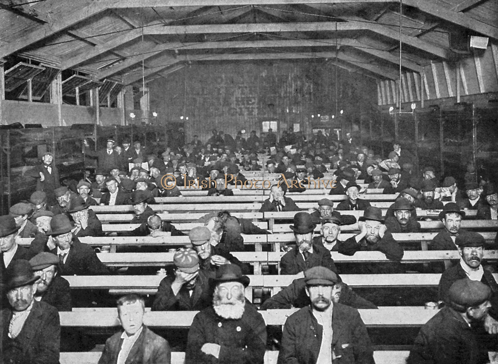 Salvation Army shelter, Blackfriars, London. The 'Penny Sit-Up' for men, where the homeless could find shelter sitting on a bench for a penny a night. Bunks round edge of room were more expensive. Early 20th century