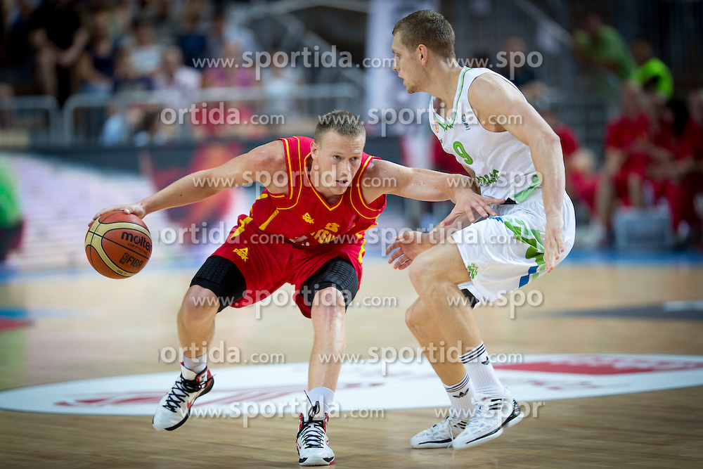 Sead Sehovic of Montenegro vs Jaka Blazic of Slovenia during friendly match between National teams of Slovenia and Montenegro for Eurobasket 2013 on August 23, 2013 in Arena Bonifika, Koper, Slovenia. (Photo by Matic Klansek Velej / Sportida.com)