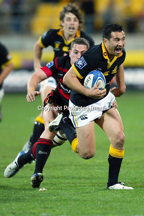 13 August 2004, Westpac Stadium, Wellington, <br /> New Zealand, Rugby Union, NPC Div 1<br /> Wellington Lions vs Canterbury<br /> Lion's Riki flutey sets up the final try for Thomas Waldrom in the dieing seconds with Canterbury's Cameron McIntyre coming in behind during Wellington's 34-22 win over Canterbury on Friday night.<br /> Please Credit: Marty Melville/Photosport