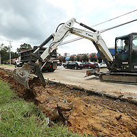 Tupelo Public Works Employee Johnny Mac, operates a backhoe to take out the old sidewalk on South Madison Street at the Main Street intersection on Tuesday. A new curb and sidewalk will be installed with ADA Handicap ramps to be built at the corners where a new cross drain was added under the street. The same work will be performed on the north side of Madison at the Main Street intersection and the work should last this week weather permitting.
