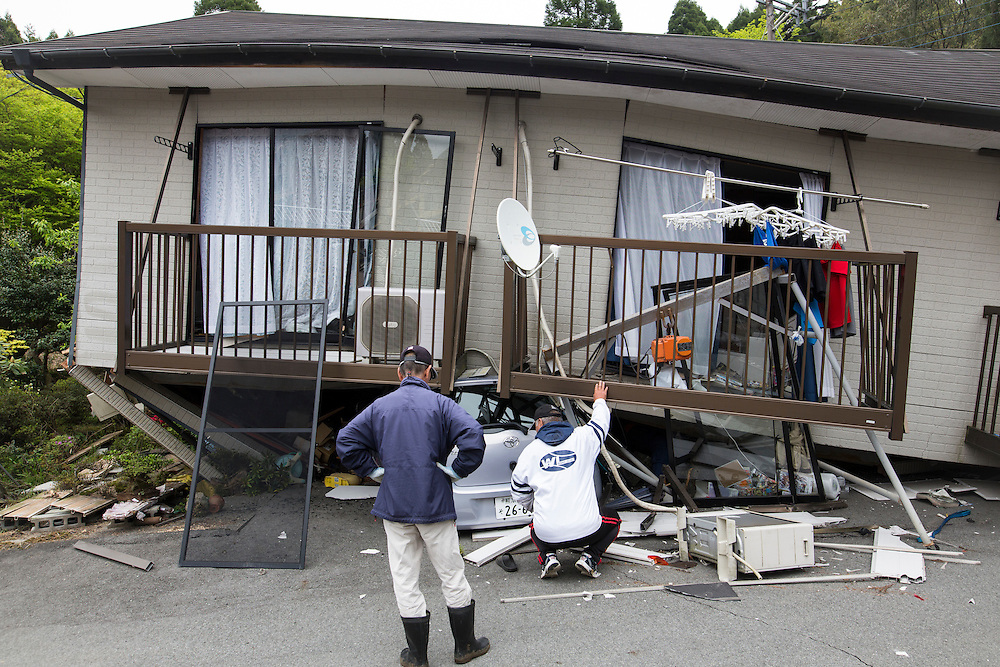 KUMAMOTO, JAPAN - APRIL 18: Resident come back to find something in front of collapsed is seen on April 16, 2016 in Minamiaso, Kumamoto, Japan. The magnitude 7.3 earthquake hit Kyushu, just after the earthquake killed 9, at least 26 new fatalities by this earthquake, total death toll from the series of earthquake rises to 35.<br /> <br /> Photo: Richard Atrero de Guzman