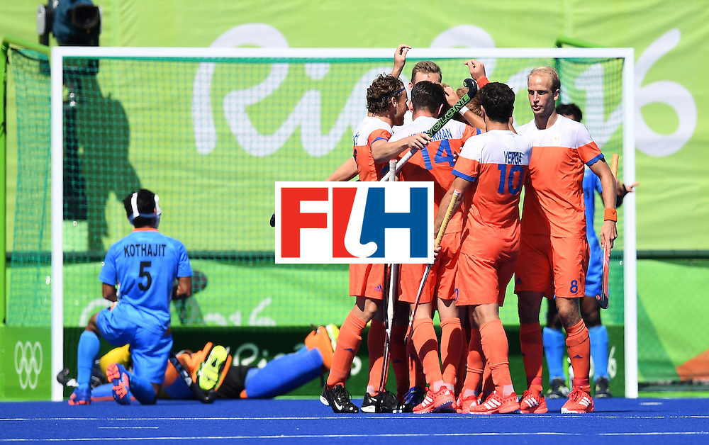 The Netherland's celebrates scoring a goal during the men's field hockey Netherland's vs India match of the Rio 2016 Olympics Games at the Olympic Hockey Centre in Rio de Janeiro on August, 11 2016. / AFP / MANAN VATSYAYANA        (Photo credit should read MANAN VATSYAYANA/AFP/Getty Images)