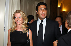 """MR EDUARDO TEODORANI-FABBRI nephew of Fiat chief Giovanni Agnelli and FRANCESCA NARDI at a party hosted by the Italian Ambassador to celebrate the forthcoming """"Made in Italy"""" event at Harrods.  The party was held at the Italian Embasy, 4 Grosvenor Square, London on 6th September 2004."""