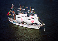 Aerial view of the Portugal Tall Ship along the Delaware River traveling north towards Philadelphia.