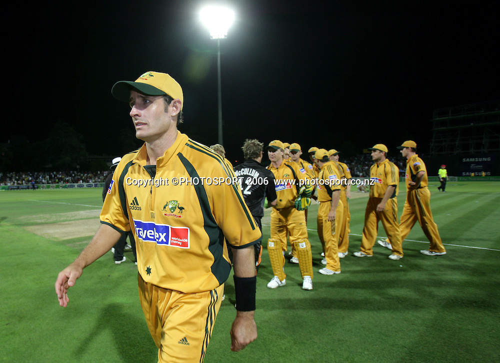 Australian Cricket captain Michael Hussey leaves the field after losing the Chappell Hadlee series 3-0 after New Zealand won the 3rd match by 1 wicket chasing Australia's 346 at Seddon Park, Hamilton, New Zealand on Tuesday 20 February 2007. New Zealand won the series 3-0. Photo: Andrew Cornaga/PHOTOSPORT<br />