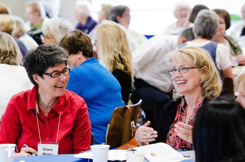Clare Meier (left) joins her table during a discussion at the  22nd Annual Concordia Conference for Parish Nurse and Congregational Health Ministries at Concordia University Wisconsin in Mequon, Wis., on Wednesday, May 28, 2014. LCMS Communications/Erik M. Lunsford