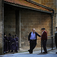 Locals look on as children penitents arrive at the church to parade during the Maundy Thursday procession on April 17, 2014 in the northern Spanish Basque village of Segura.   PHOTO/ RAFA RIVAS