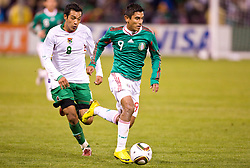 February 24, 2010; San Francisco, CA, USA;  Mexico forward Alberto Medina (9) dribbles past Bolivia forward Gilbert Alvarez (9) during the second half at Candlestick Park. Mexico defeated Bolivia 5-0.]