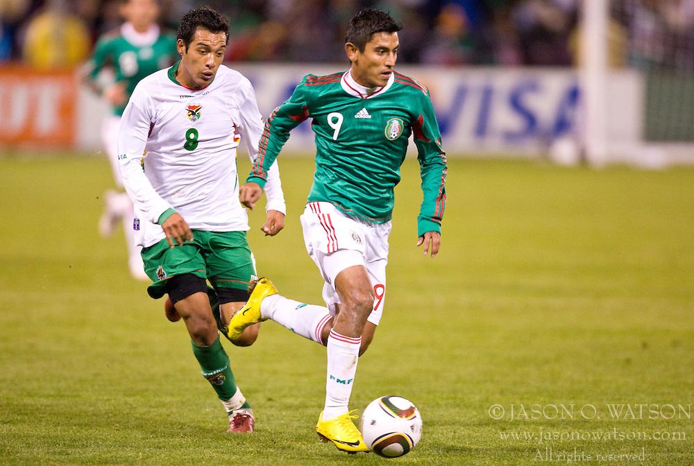 February 24, 2010; San Francisco, CA, USA;  Mexico forward Alberto Medina (9) dribbles past Bolivia forward Gilbert Alvarez (9) during the second half at Candlestick Park. Mexico defeated Bolivia 5-0.]