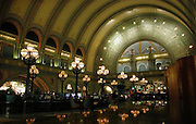 The original lobby of the St. Louis Union Station, Missouri is now the Grand Hall Lounge adjacent to the Hyatt Regency Hotel. The multiple arches, ornate detail,and wall paintings of women holding torches that are actually lights and the stained glass windows with three Grecian women representing San Francisco, St. Louis and New York, the cities which had the largest train stations at the time Union Station was built.  Photo by Lance Cheung