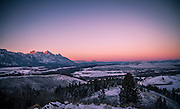 Winters sunset with Alpenglow in the far north over Yellowstone