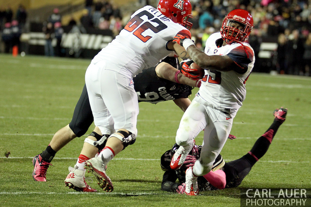 October 26th, 2013:  University of Arizona Wildcats junior running back Ka'Deem Carey (25) powers his way to the end zone for a touchdown in the fourth quarter of the NCAA football game between the University of Arizona Wildcats and the University of Colorado Buffaloes at Folsom Field in Boulder, Colorado