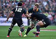 JOHANNESBURG, South Africa, 04 October 2014 : Duane Vermeulen of the Springboks takes the hit by Keven Mealamu of the All Blacks with Malakai Fekitoa (12) in support during the Castle Lager Rugby Championship test match between SOUTH AFRICA and NEW ZEALAND at ELLIS PARK in Johannesburg, South Africa on 04 October 2014. <br /> The Springboks won 27-25 but the All Blacks successfully defended the 2014 Championship trophy.<br /> <br /> © Anton de Villiers / SASPA