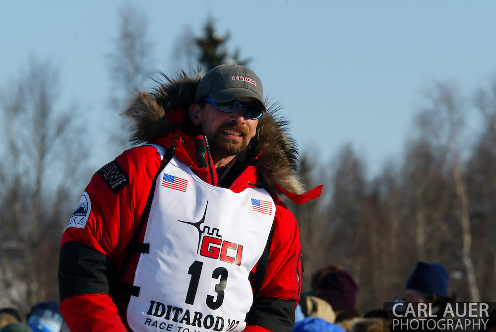 3/4/2007:  Willow, Alaska -  With this be lucky 13?  2007 Yukon Quest Champion Veteran Lance Mackey of Kasilof, AK wearing the same bib number (13) that both his father and brother wore when they crossed the finish line in Nome hopes that this is his year as he starts the 1040 mile journey in the 35th Iditarod Sled Dog Race