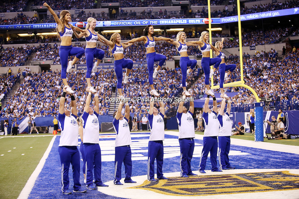 Member of the Blue Stampede cheer squad stand atop the hands of teammates as they cheer for the team during the Indianapolis Colts 2015 NFL week 2 regular season football game against the New York Jets on Monday, Sept. 21, 2015 in Indianapolis. The Jets won the game 20-7. (©Paul Anthony Spinelli)