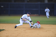 Mississippi's Alex Yarbrough (2) tags out Austin Peay's Jared Delong (3) at Oxford-University Stadium in Oxford, Miss. on Tuesday, March 9, 2010.