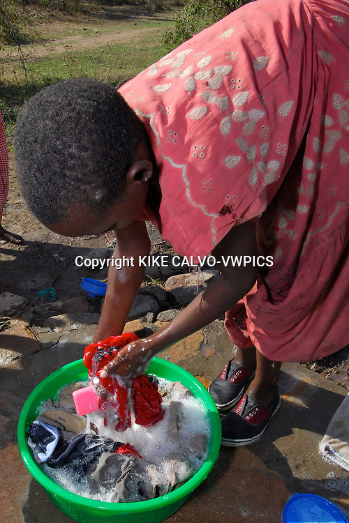 Thanks to foreign aid and projects such as the ones developed in the Small Grants Programme from the United Nations, local communities such as this remote village have access to water. Masai Mara tribe around the Masai Mara National Park. Kenya. East Africa.