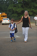 Sonya Dye (right) walks her son Jack into school on the first day of school at Bramlett Elementary in Oxford, Miss. on Thursday, August 4, 2011.