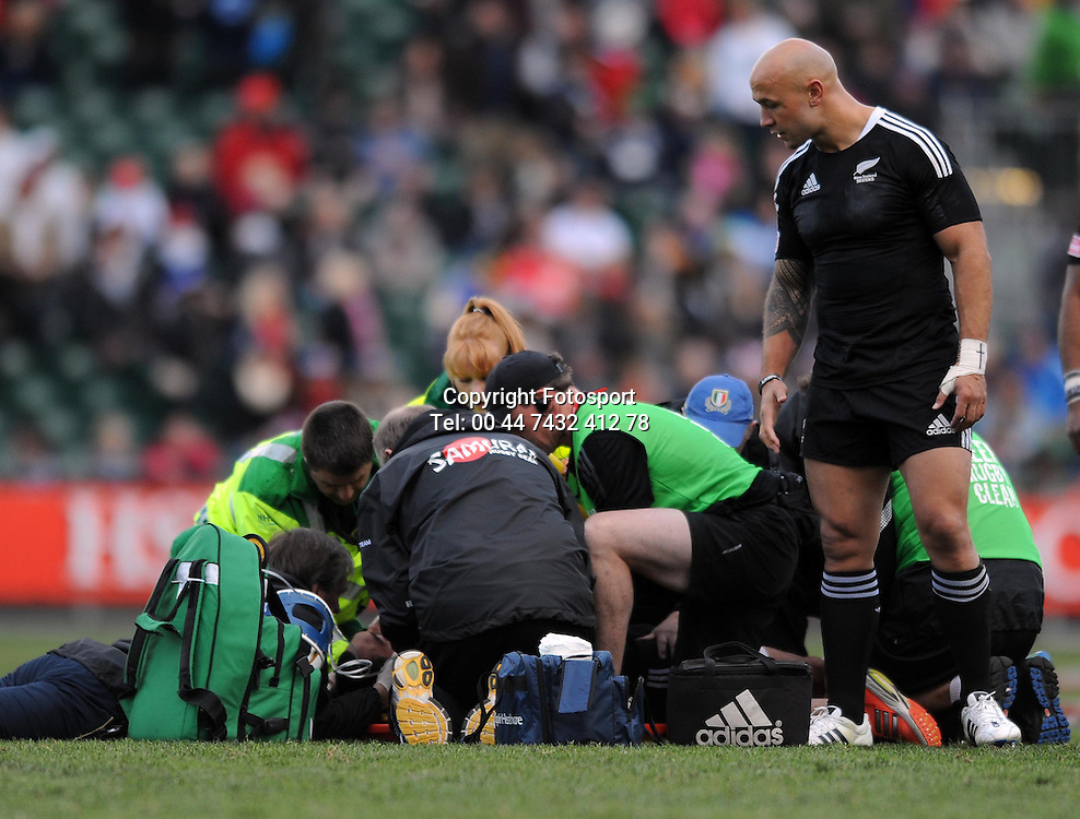 New Zealand's Bryce Heem lies injured after taking a heavy fall in a tackle, as his captain DJ Forbes looks on.<br /> New Zealand v England, Cup Final, IRB Sevens World Series, round 8, Day 2, Scotstoun Stadium, Glasgow, Scotland, Sunday 6th May 2012.<br /> PLEASE CREDIT ***FOTOSPORT/DAVID GIBSON***